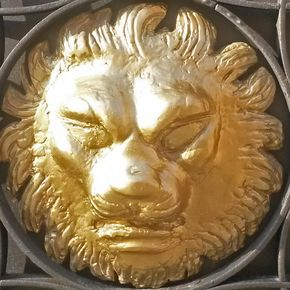 palazzo vitali lion head on gate